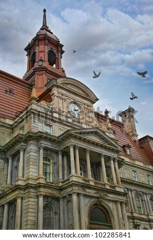 Ornate detail of an old building in Montreal - stock photo