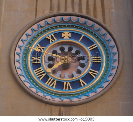 Ornate face of clock at Norwich cathedral, Norfolk - stock photo