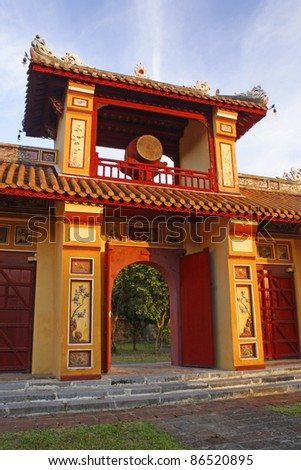 Ornate gate or entrance inside the purple forbidden city in Hue in Central Vietnam South East Asia - stock photo