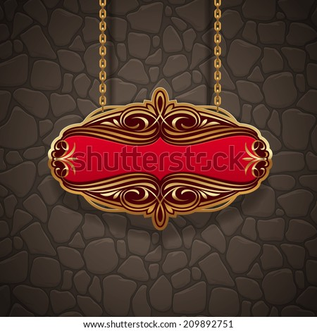 Ornate gold vintage signboard hanging on chains against a stone wall - stock photo