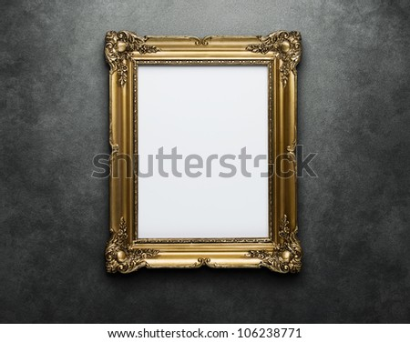 Ornate golden frame at the concrete wall with clipping path for the inside - stock photo