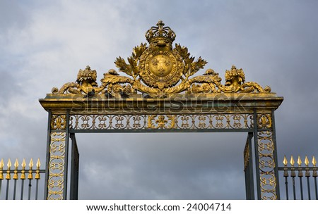 Ornate golden gate entry leading into the Ch?teau de Versailles; France - stock photo
