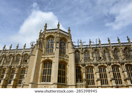 Ornate Gothic 15th century facade of St Georges Chapel in Windsor Castle, UK, the official residence of the Queen and famous tourist attraction - stock photo