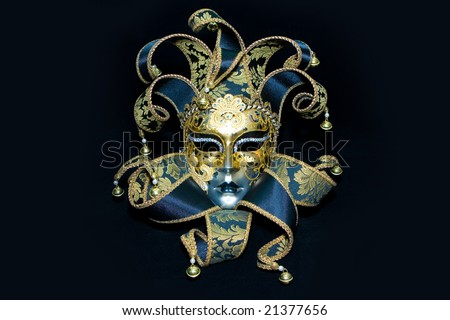 Ornate handmade venetian mask on black background - stock photo