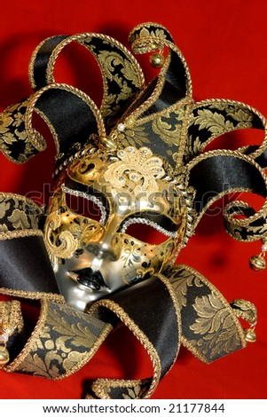 Ornate handmade venetian mask on red background