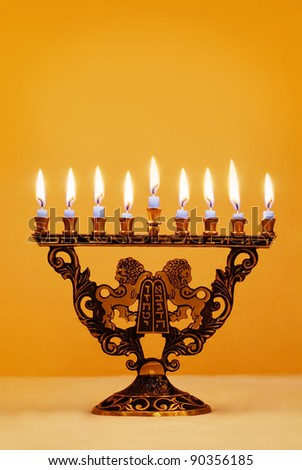 Ornate Hanukkah menorah with lions holding the Ten Commandments - stock photo