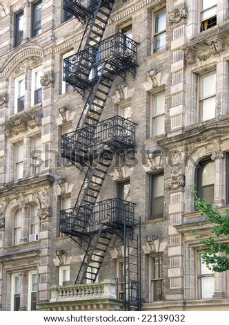 Ornate Harlem apartment building with extensive fire escapes - stock photo