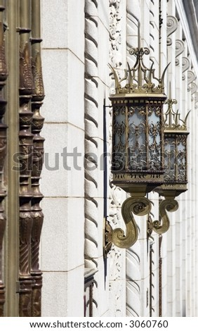 Ornate lamps on the exterior of an old, historic office building in Tulsa, OK. - stock photo