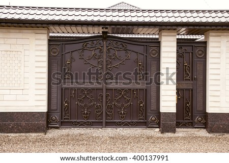 ornate metal gates in the design of granite - stock photo