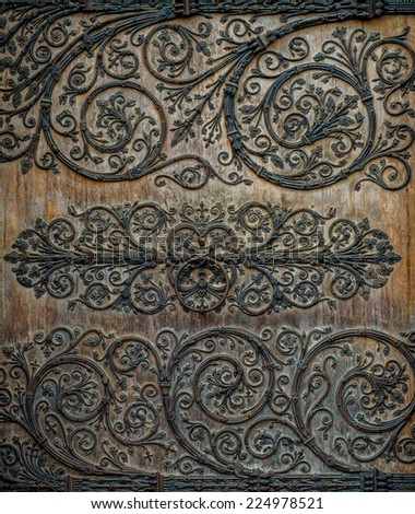 Ornate Metalwork On Door Of Medieval Notre Dame Cathedral In Paris France - stock photo