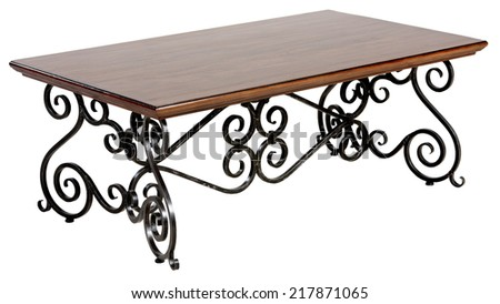Ornate old table with iron base - stock photo