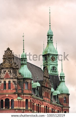 Ornate roof, gables and bell tower on historic office building at  Speicherstadt district, Hamburg - stock photo