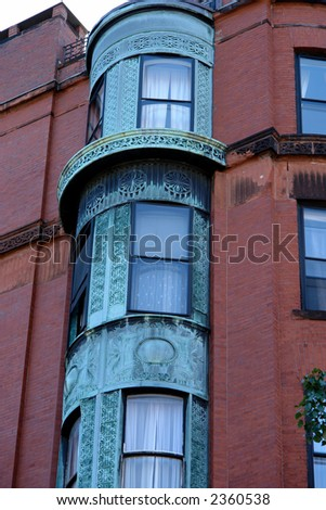 ornate rounded bay windows on old brownstone apartment house in boston's back bay