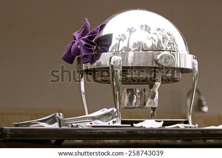 Ornate silver server at a classy breakfast bar - stock photo