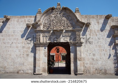 Ornate stone carved entrance to the 18th century baroque style Spanish colonial house in Arequipa, Peru - stock photo