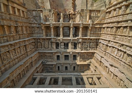 Ornate stone carved walls lining the 11th century Rav-Ki-Vav stepwell at Patan, Gujarat, India. Selected as a UNESCO world Heritage Site in June 2014. - stock photo