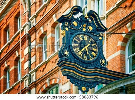 Ornate Street Clock in London. - stock photo
