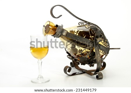 ornate swivel frame and holder decanting wine into glass - stock photo