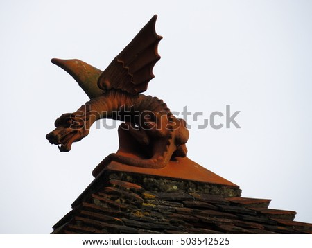 ornate terracotta dragon stalks its prey