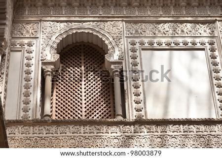 Ornate window in the Patio de las Munecas en el Real Alcazar de Sevilla. Courtyard of the dolls in the Royal Alcazar of Seville, Spain. UNESCO World Heritage Site - stock photo