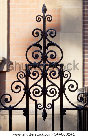 Ornate Wrought Iron Fencing. In the inner city of London ornate black wrought iron fencing is found everywhere to the point they fade into the background.  - stock photo