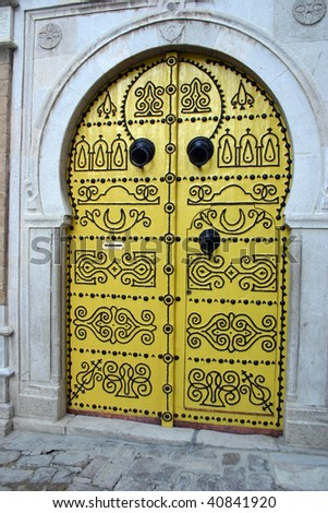 Ornate Yellow nailed doors in the outside the medina in Tunis