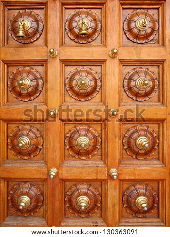 Ornated door of the hindu temple - stock photo