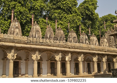 Ornately carved stonework of a colonnade surrounding the courtyard of the Hutheesing Temple in Ahmadabad, Gujarat, India. Jain temple built circa 1848.