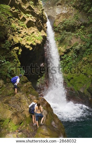 Oropendola Waterfall in Costa Rica attracts tourists to its clear swimming pool - stock photo