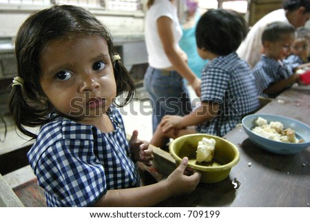 Orphan Girl Eating - stock photo
