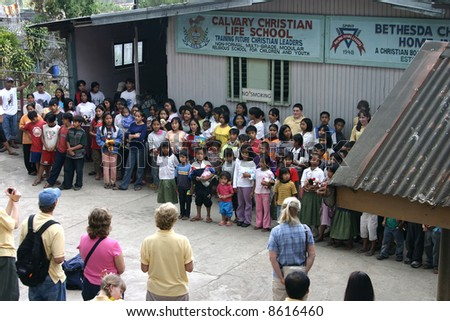 orphanage in the Philippines with visitors - stock photo