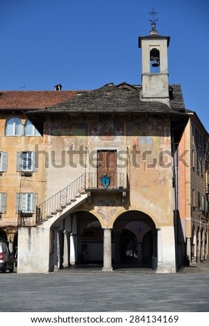 ORTA SAN GIULIO, ITALY - February 19: Orta The Palace of the Community or Broletto, on February 19, 2015 in Orta, Italy - stock photo