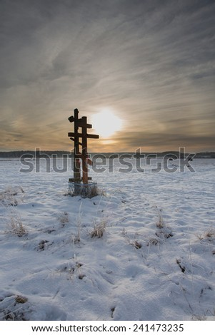 Orthodox church crosses in sunset light against cloudy sky  in winter - stock photo