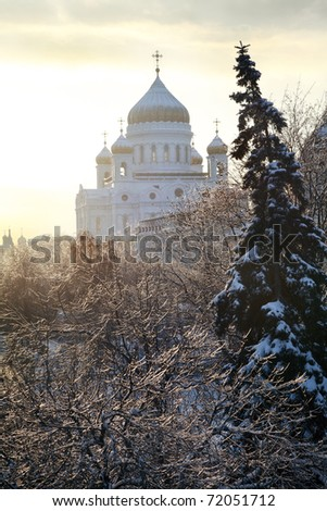 Orthodox church of Christ the Savior and trees after ice storm in Moscow, Russia - stock photo