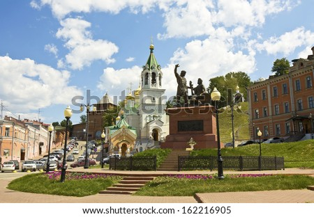 Orthodox church of John the Baptist and monument to Minin and Pozharskiy in Nizhniy Novgorod, Russia. - stock photo