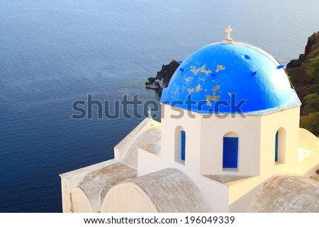 Orthodox church painted blue and white on the island of Santorini, Greece - stock photo