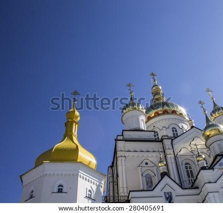 Orthodox church with golden domes in Pochaev Lavra, Ukraine - stock photo