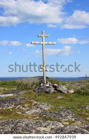 Orthodox cross on the island in the White sea