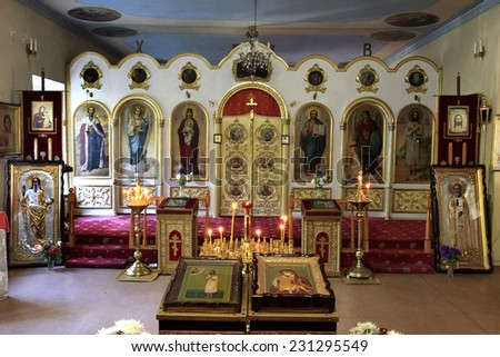 Orthodox Holy Transfiguration Cathedral. New carved wooden doors into the altar of an Orthodox church  - stock photo