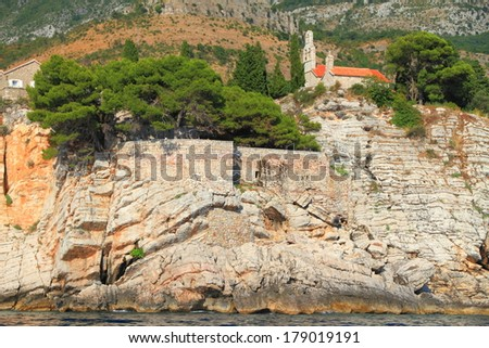 Orthodox monastery from the Adriatic sea area built on top of a cliff - stock photo