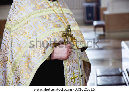 orthodox priest with a cross in church - stock photo