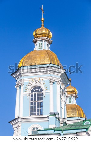 Orthodox St. Nicholas Naval Cathedral, facade fragment with golden domes, Saint-Petersburg, Russia - stock photo