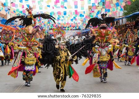 ORURO, BOLIVIA - MARCH 5: Dancers at Oruro Carnival in Bolivia, declared UNESCO Cultural World Heritage on March 5, 2011 in Oruro, Bolivia - stock photo