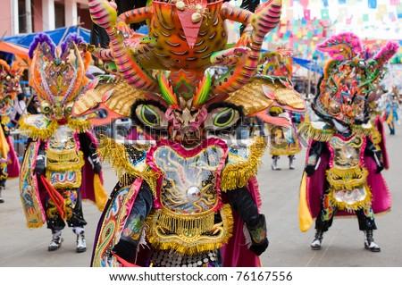 ORURO, BOLIVIA - MARCH 5: Devil Dancers at Oruro Carnival in Bolivia, declared UNESCO Cultural World Heritag on March 5, 2011 in Oruro, Bolivia - stock photo