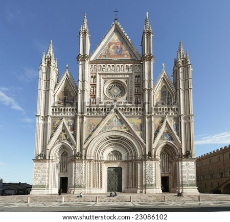 Orvieto Cathedral, Umbria, Italy Orvieto is noted for its Gothic cathedral, or duomo. The church is striped in white travertine and greenish-black basalt in narrow bands. - stock photo