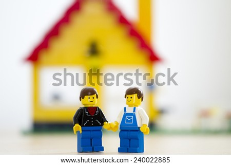 Orvieto, Italy - July 23th 2014: Lego mini figure gay man embrace in front of their house. Lego is a popular line of construction toys manufactured by the Lego Group - stock photo