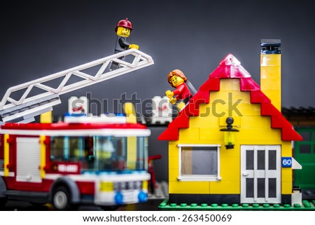 Orvieto, Italy - March 25th 2015: Lego fireman rescues a woman. Lego is a popular line of construction toys manufactured by the Lego Group