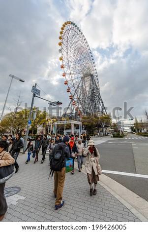 OSAKA - APR 6: Tempozan Ferris Wheel on Apr 6, 14 in Osaka. It is located in Osaka, Japan, at Tempozan Harbor Village, next to Osaka Aquarium Kaiyukan. - stock photo