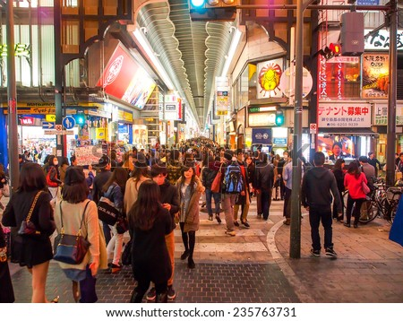 OSAKA -APR 12: Tourists at shopping street in Osaka, Japan on Apr 12, 2014. Osaka is Japan's third largest city by population and well know as economic hub of Kansai area. - stock photo