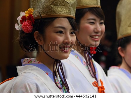 OSAKA -APRIL 7: Japanese shinto maidens (miko) in traditional kimono during shintoist ceremony on April 7th 2016 in Osaka, Japan. Shinto is traditional japanese religion and priests are very respected
